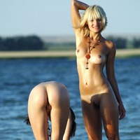 There two nude girls in focus at photo 2