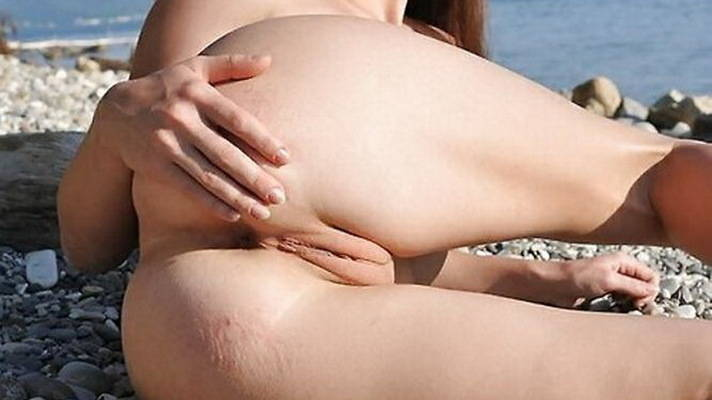 Seductive young nudist ass on the beach